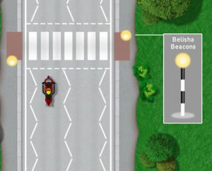 'Belisha Beacon' flashing amber lights at zebra crossings