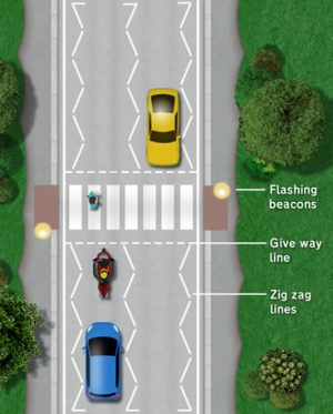 Zebra crossings can be seen from a distance due to the flashing yellow beacons
